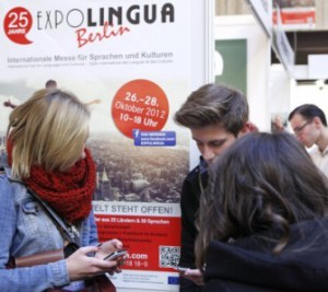 Teens learning with their smartphone at a fair